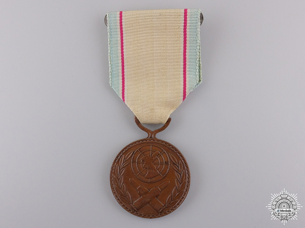 A Korean War Service Medal with Crossed Bullets