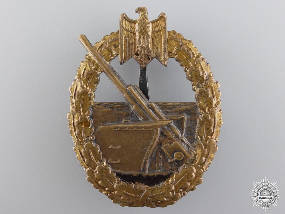 A Kreigsmarine Naval Artillery Badge by Juncker