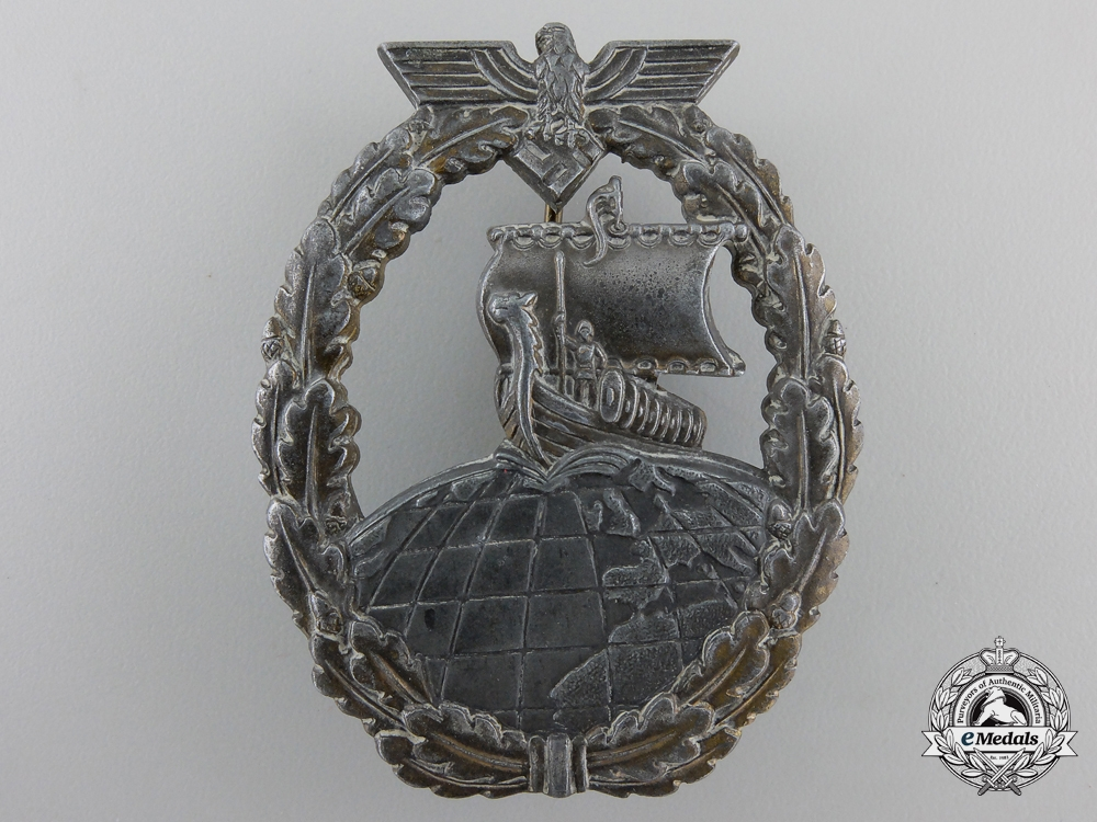 A Kriegsmarine Naval Auxiliary Cruiser Badge by Friedrich Orth