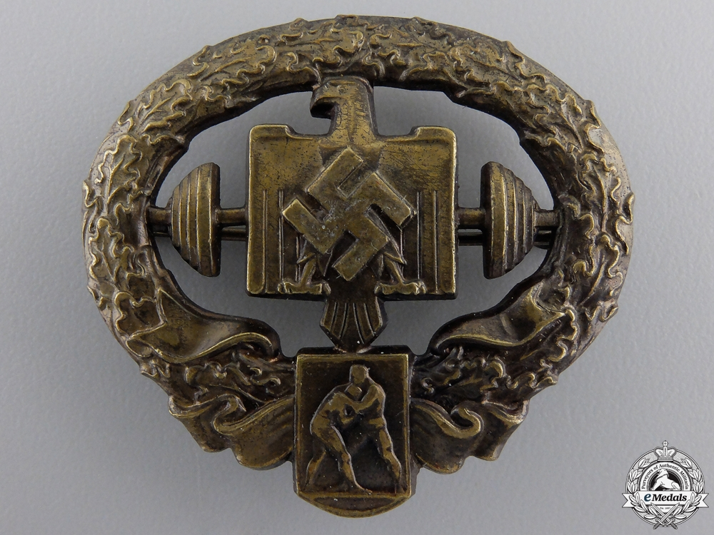 A Mint Heavy Athletics Sports Badge