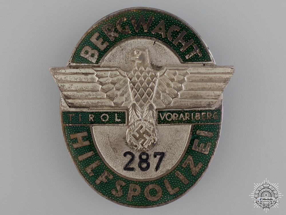 A Rare & Previously Published Mountain Guard Executive Badge