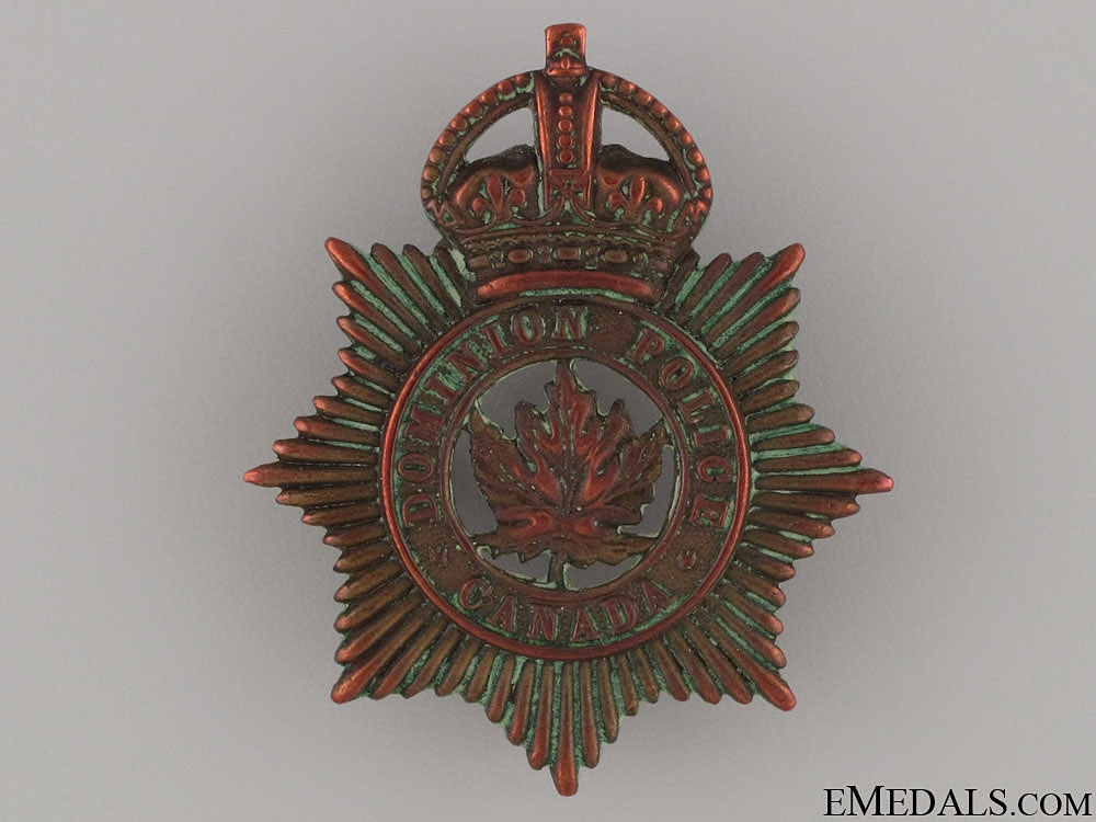 A Rare NWMP Dominion Police Cap Badge