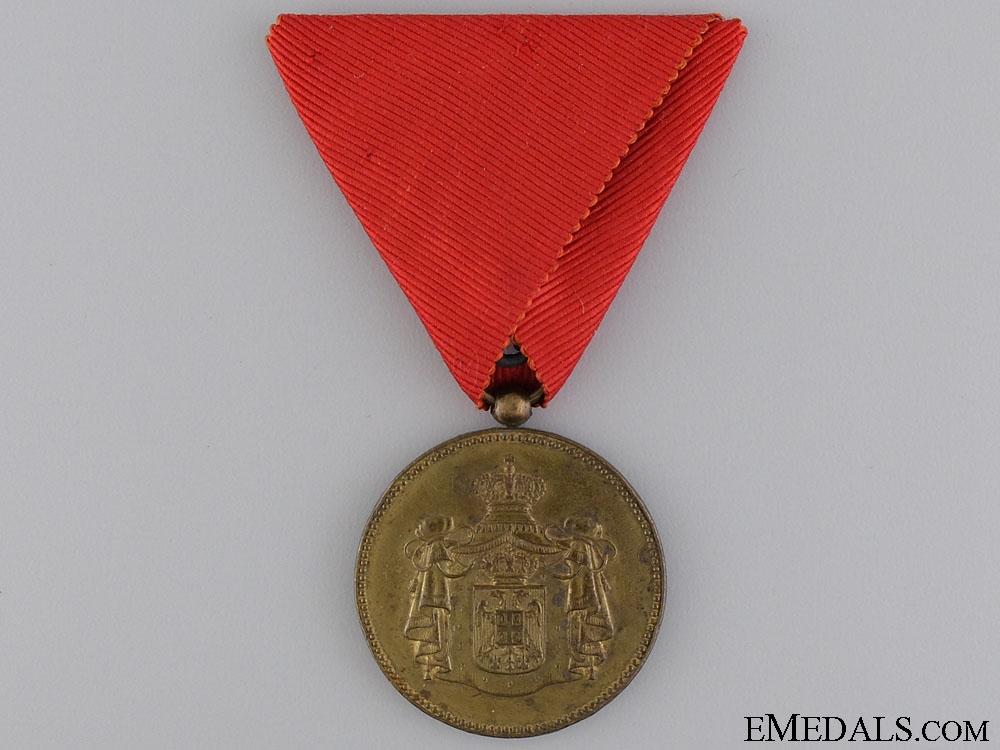 A Serbian Civil Merit Medal; Gold Grade
