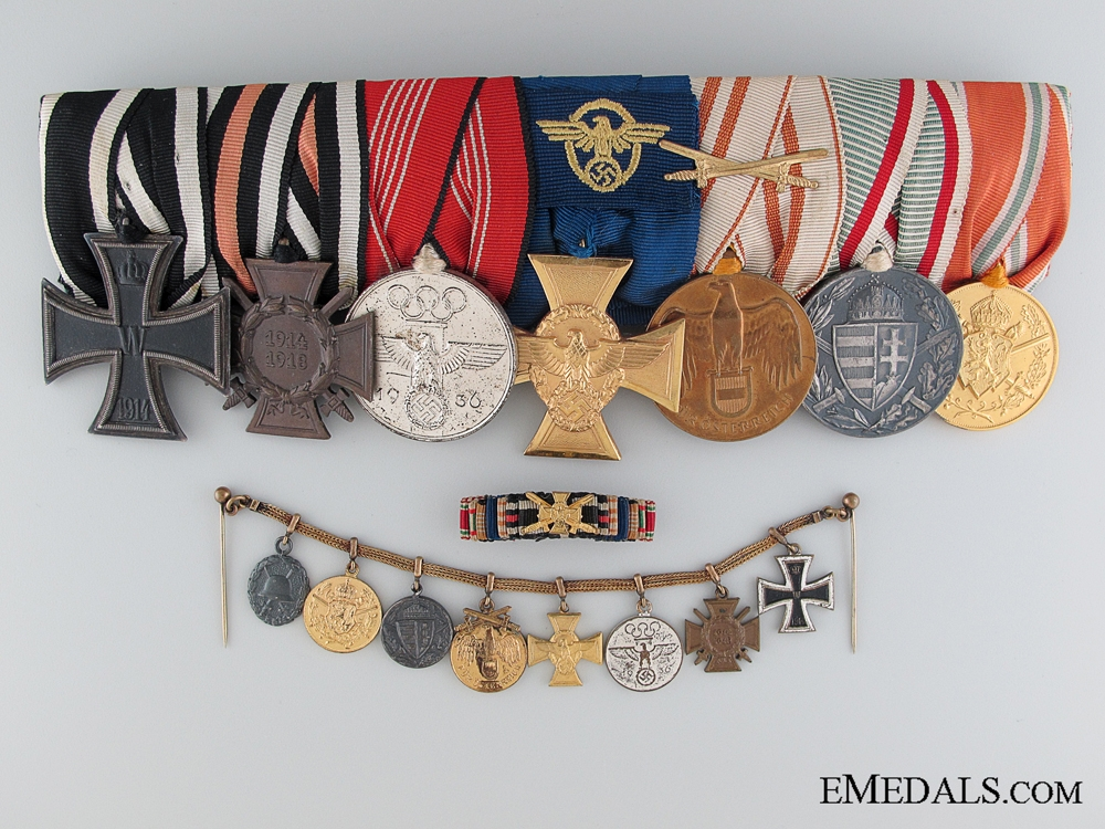 A Seven Piece German Medal Bar with  Matching Miniatures