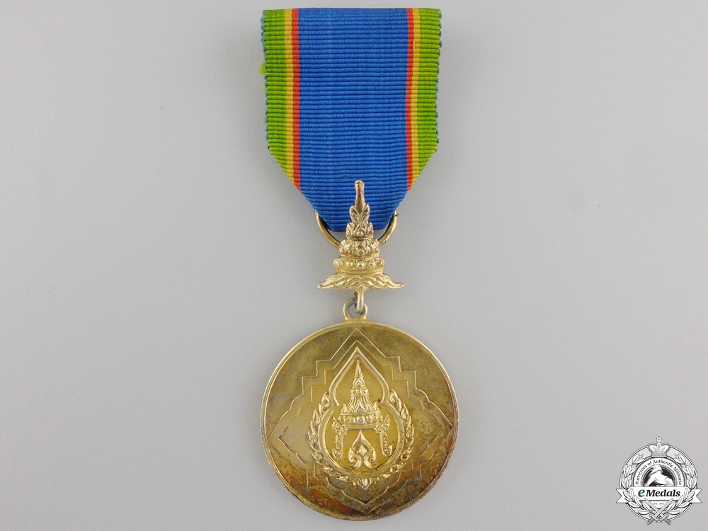 A Thai Order of the Crown; Gold Grade Medal