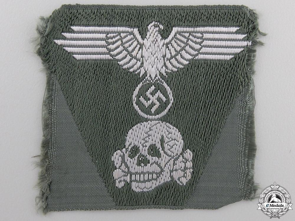 A Waffen-SS Cap Trapezoid Cap Insignia