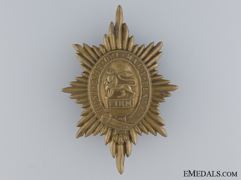 A Worchestershire Brass Puggaree Badge