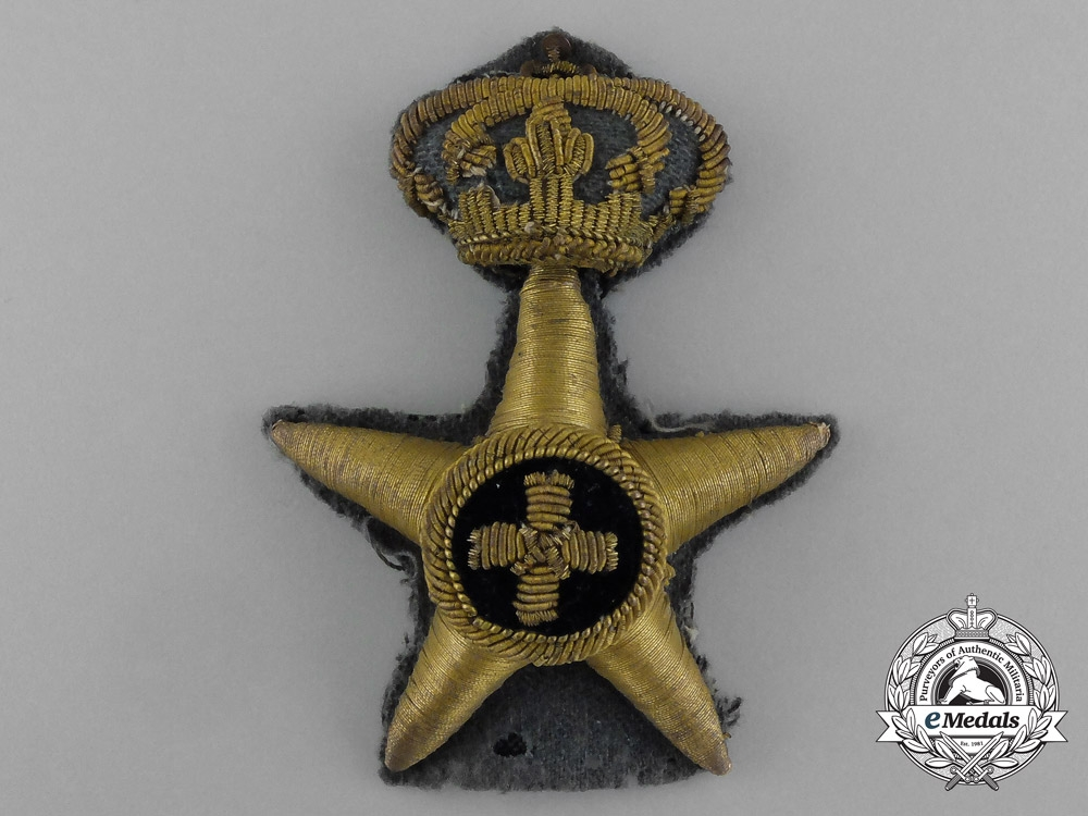 An Italian Colonial Forces Administrative Corps Badge