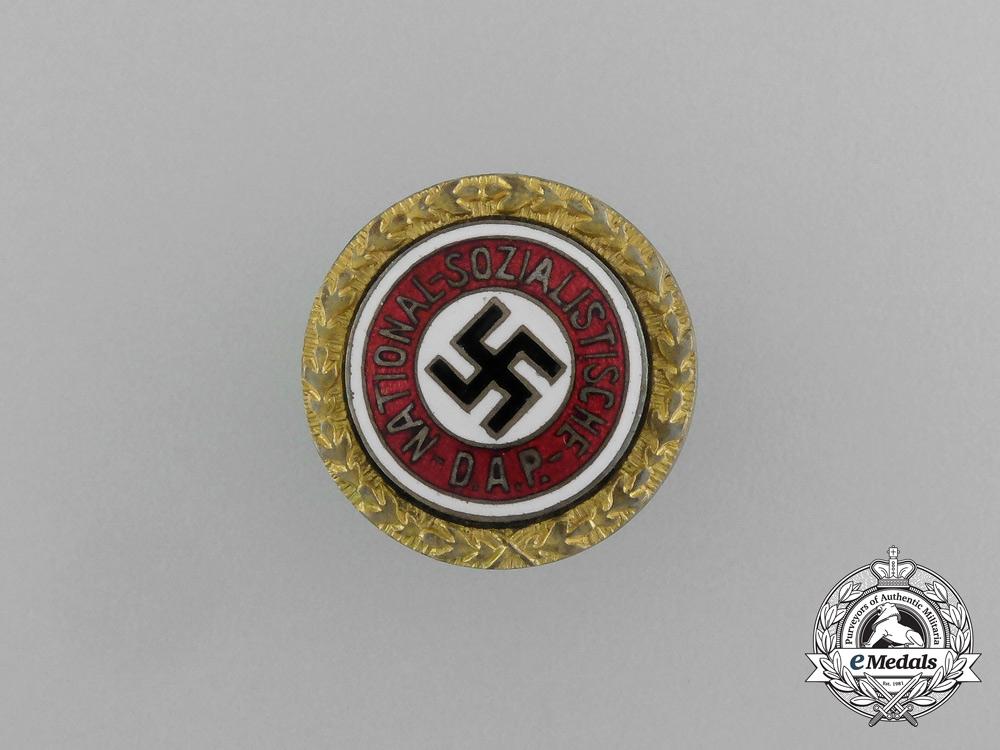 An NSDAP Golden Party Badge to Edmund Hohmann by Josef Füss