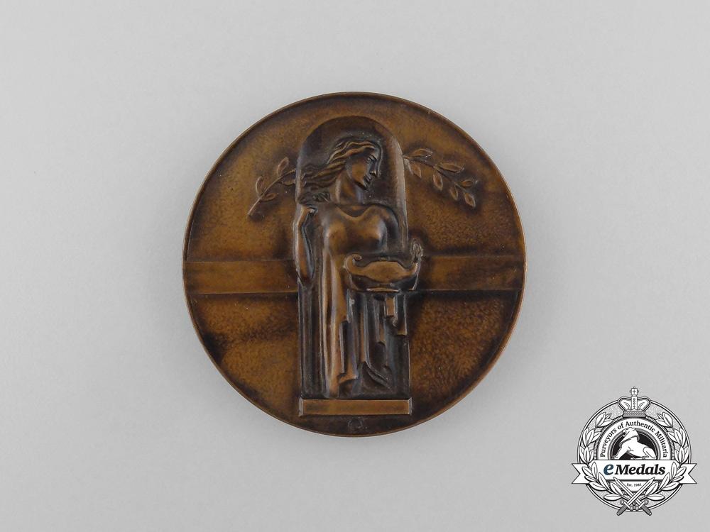 "A Finnish ""Finlandia Mindful of Human Kindness""  Medal"