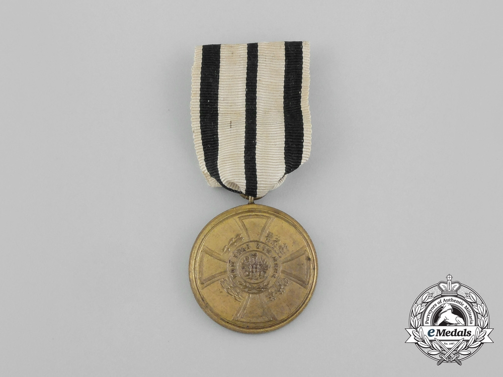 A 1848-1849 Prussian Hohenzollern Campaign Medal with its Original Wrapping Paper
