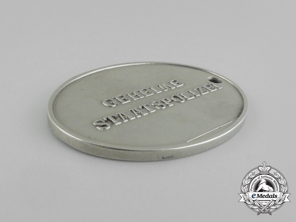 A Mint and Unissued German Gestapo (Secret State Police) Identification Tag