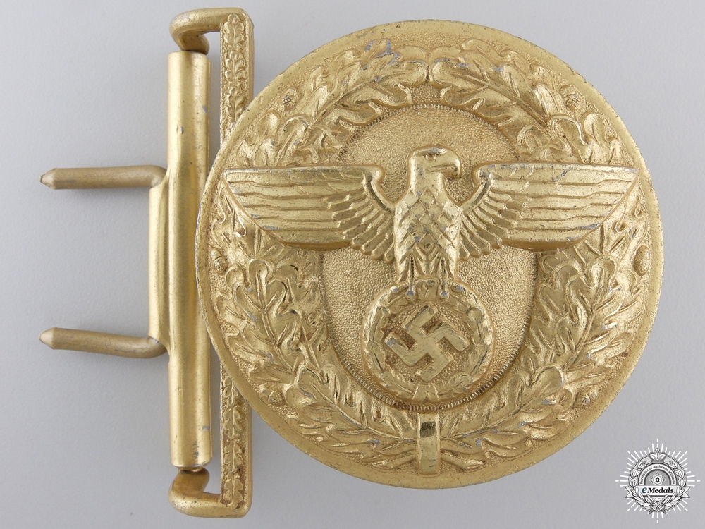 An NSDAP Leaders Belt Buckle by F.W. Assmann & Sohne in Tombac