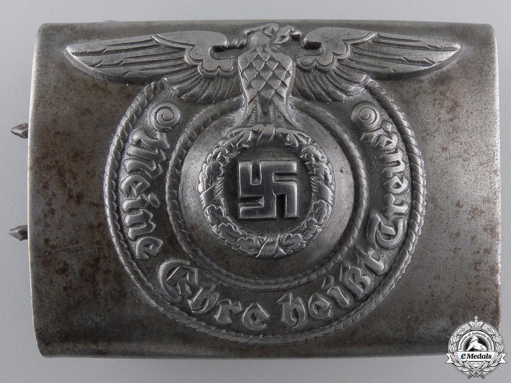 An RZM EM/NCO SS Belt Buckle by Assmann