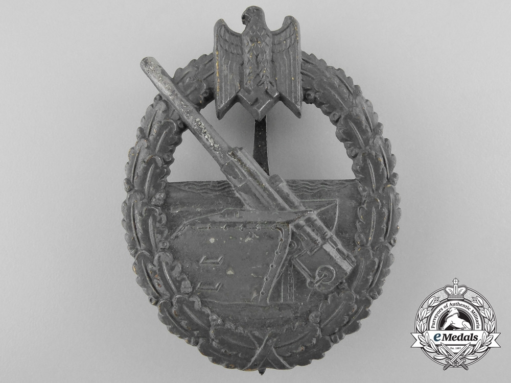 A Kriegsmarine Coastal Artillery Badge by Funke & Brüninghaus, Lüdenscheid