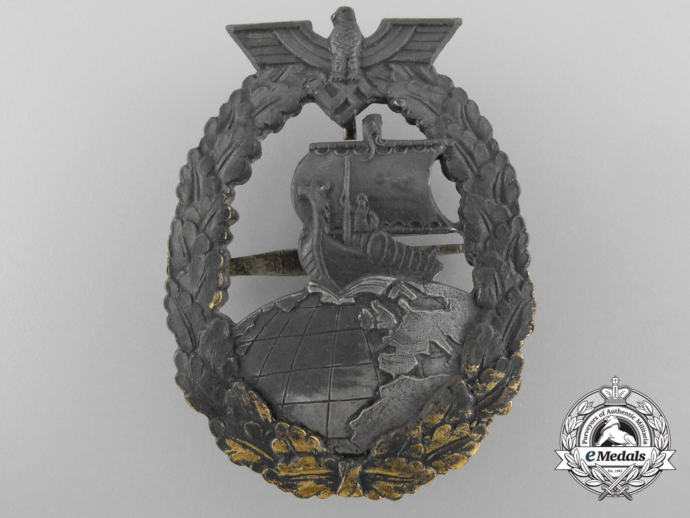 A Kriegsmarine Auxiliary Cruiser  Badge by French Maker Bacqueville, Paris