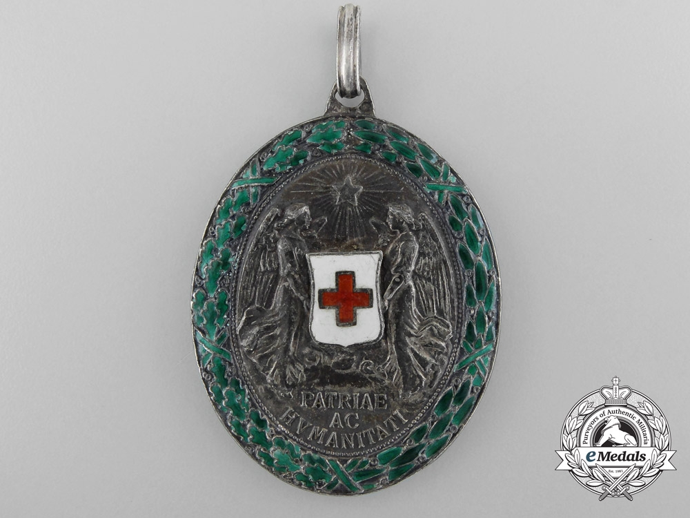 An Austrian Honour Decoration of the Red Cross; Silver Medal with War Decoration