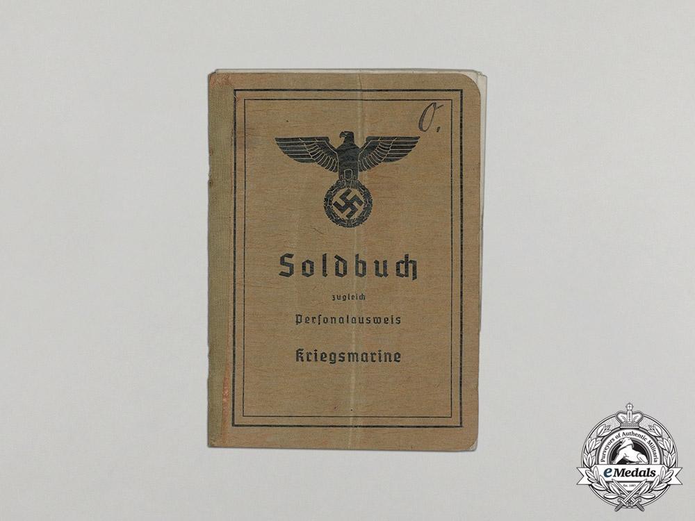 Germany, Kriegsmarine. A Blockade Runner Badge Group to Mechanic Otto Ollech, KIA 1943