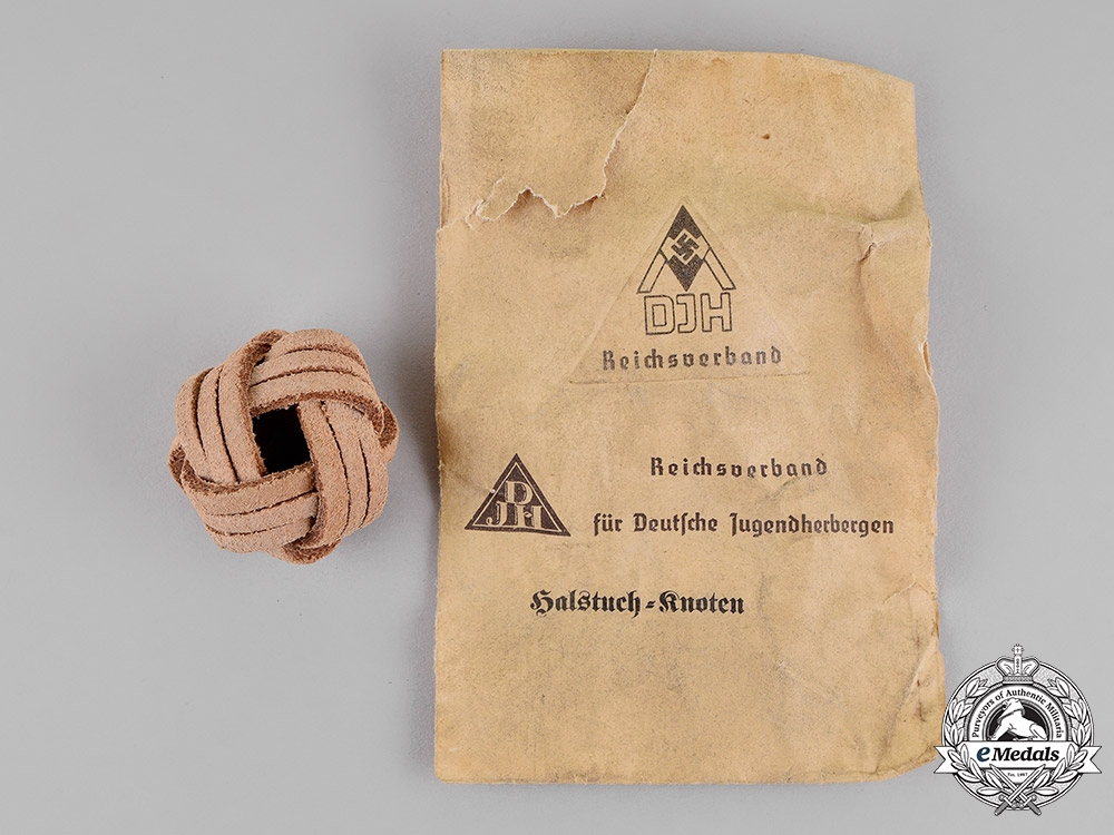 Germany. A DJ/HJ Neckerchief Knot in its Packet of Issue