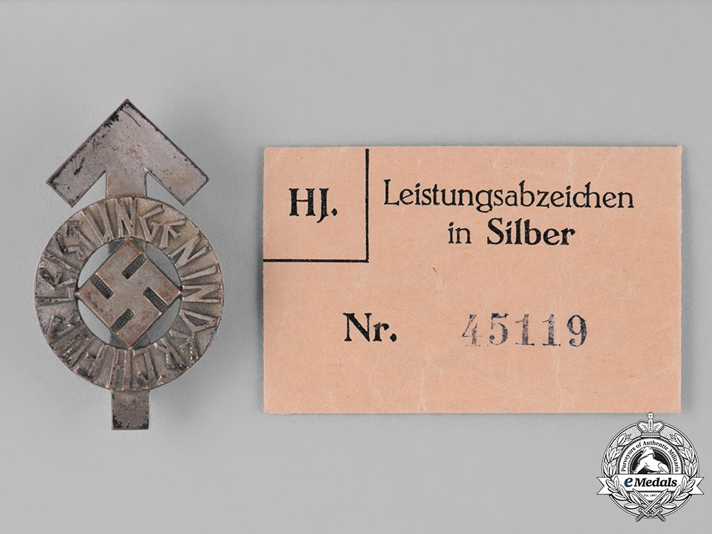 Germany. An HJ Proficiency Badge, Silver Grade, with its Original Paper Packet of Issue