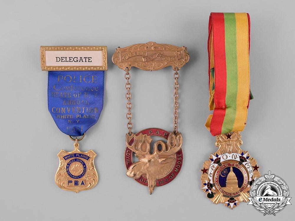 United States.  Eight Association Badges & Insignia