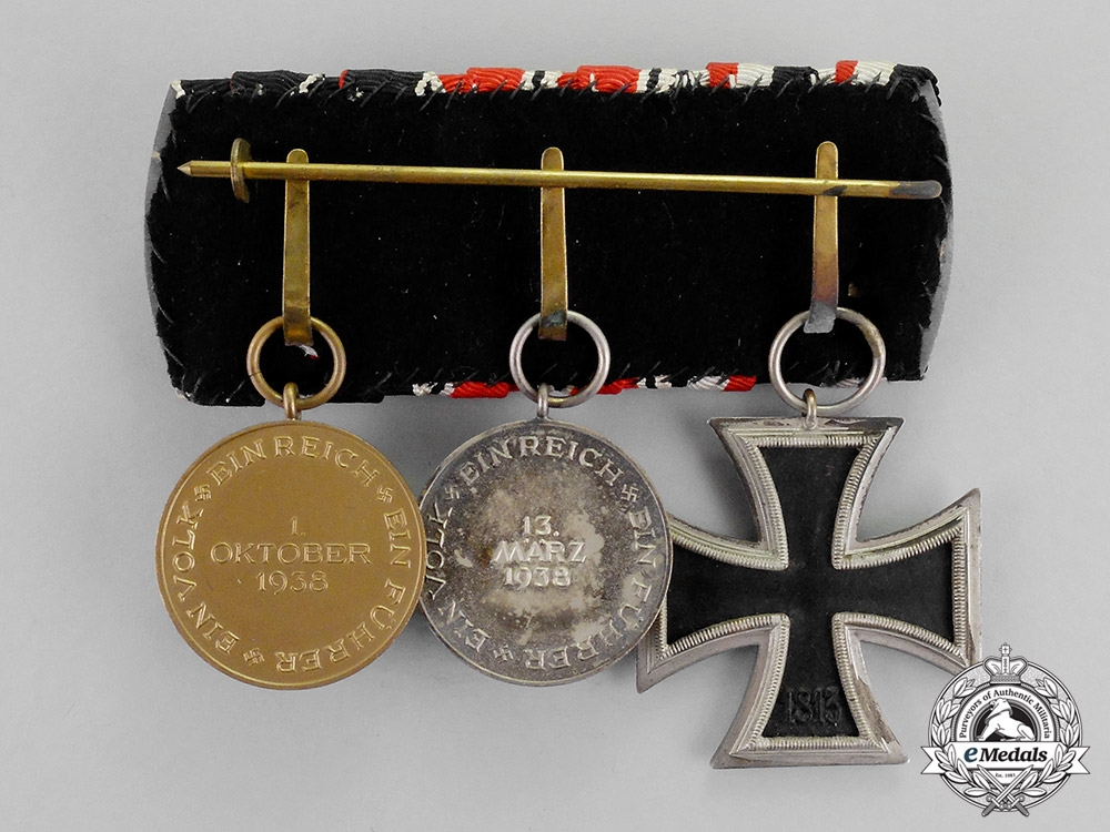 Germany an ek2 medal bar with three medals awards and for Awards and decoration