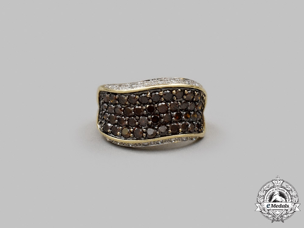 Jewellery. An Orange & White Diamond Multi-Row Ring in Yellow Gold