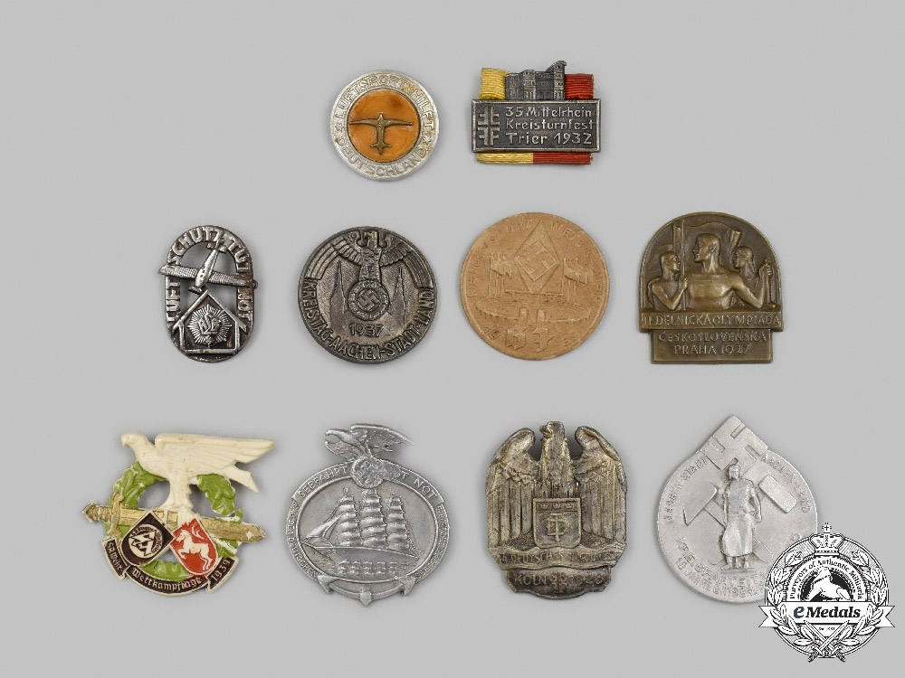 International. A Mixed Lot of Commemorative Badges