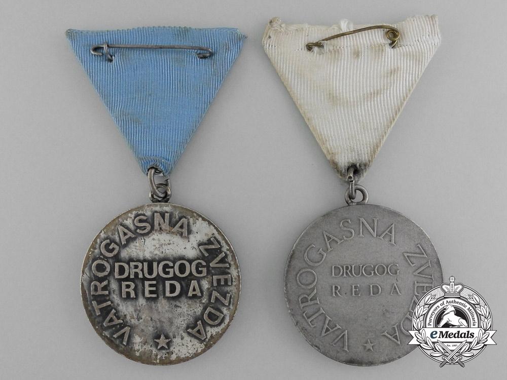 "Socialist Yugoslavia, Socialist Republic. Two Firefighting ""Fire Star"" Medals; Silver Grade"