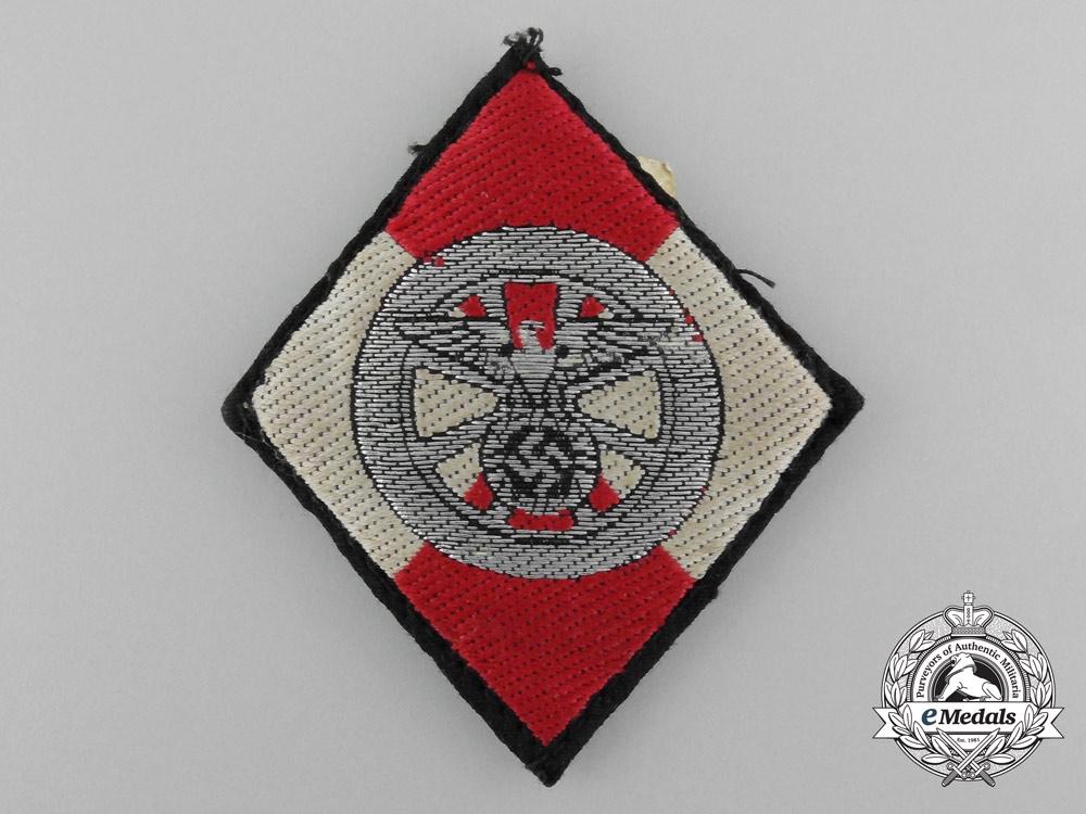 An NSKK Sleeve Diamond Insignia for Former HJ Members by Zieh-Press-und Stanzwerk G.m.b.H.