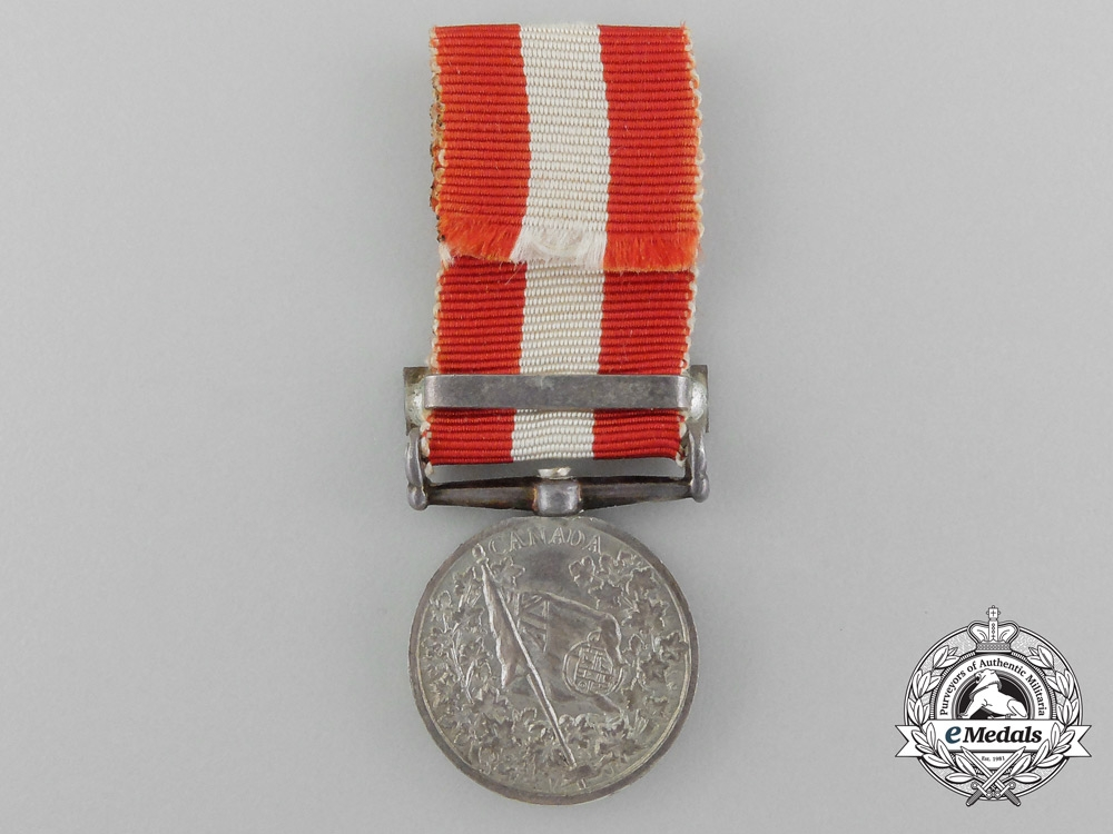 A Canada General Service Medal with Miniature, Photograph of Recipient, & Carton