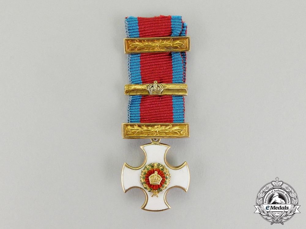 Great Britain. A Miniature Gold Distinguished Service Order with Bar