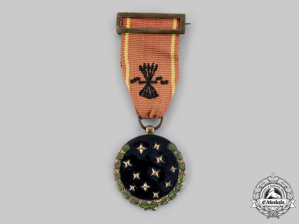 Spain, Fascist State. A Party Member's Medal with Name c.1942