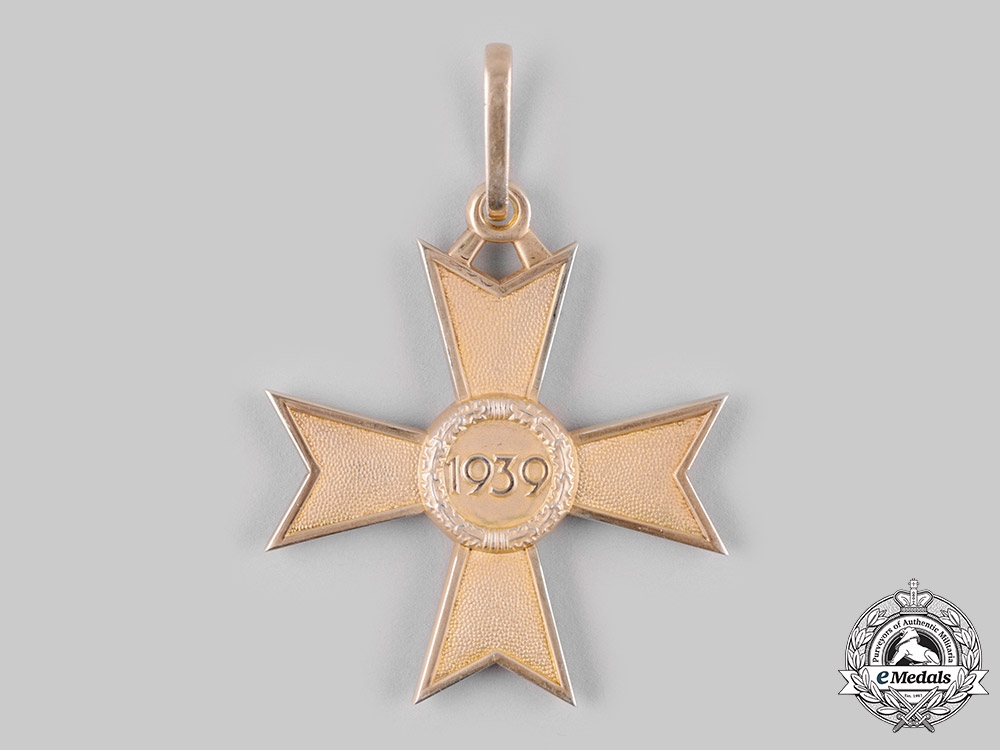 Germany, Wehrmacht. A Rare Knight's Cross of the War Merit Cross in Gold, by Deschler & Sohn