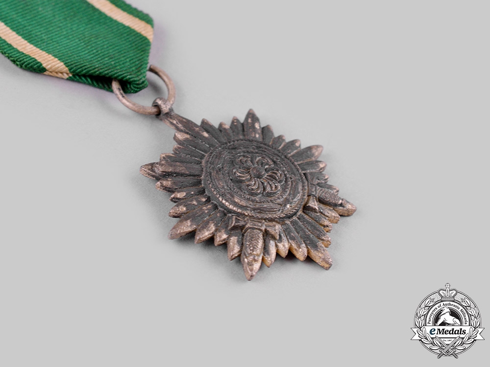 Germany, Wehrmacht. An Eastern Peoples Medal with Swords, II Class, Silver Grade