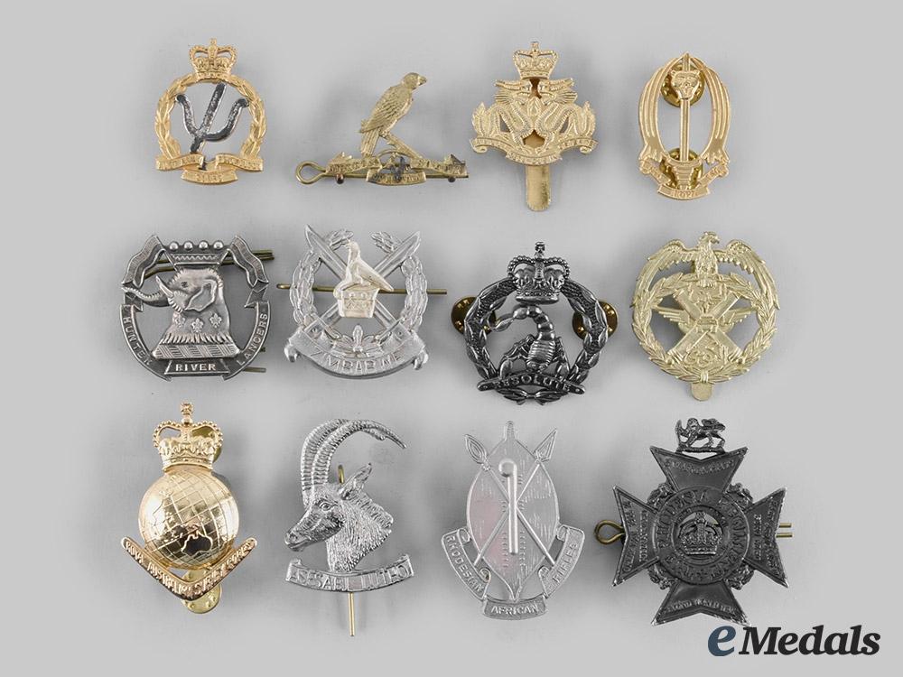 Australia, Hong Kong, Kuwait, New Zealand, Rhodesia, Zaire, Zimbabwe. A Lot of Twelve Cap Badges