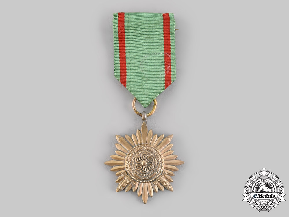 Germany, Wehrmacht. An Eastern People's Medal, II Class in Gold with Swords, by Wächtler & Lange