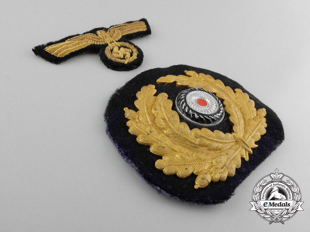 A Set of Kriegsmarine Navy Officer Peak Cap Badges