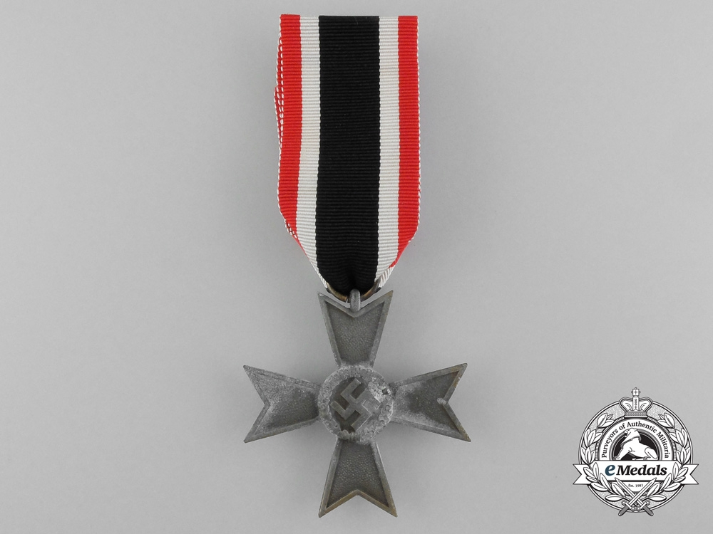 A War Merit Cross Second Class (Kriegsverdienstkreuz 2. Klasse ohne Schwerter); in bronze; with original unworn ribbon and packet of issue and paper wrappings; ribbon is vertically striped red-white-black-white red; measuring 47 mm x 48 mm; ribbon in mint
