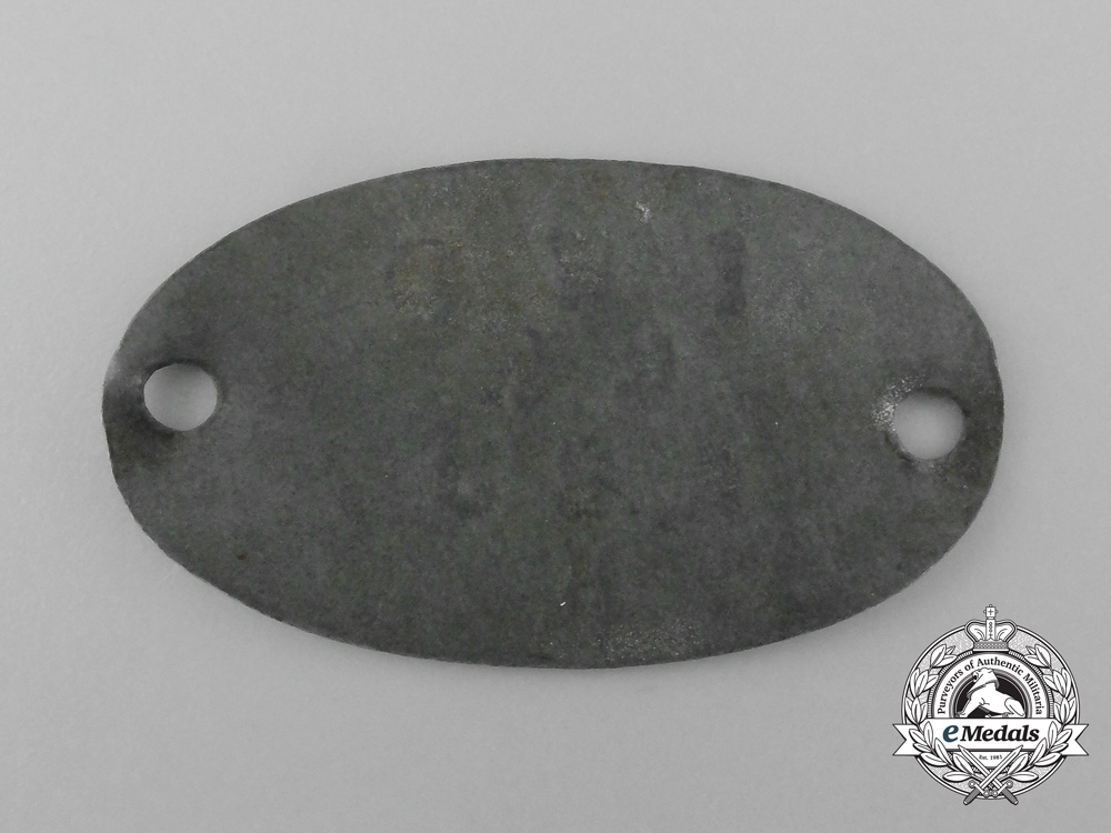 A Scarce First War German Internment Camp Allied Identification Tag