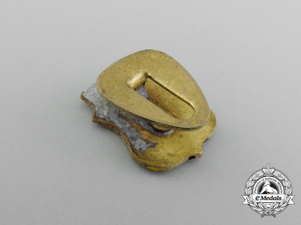 A Spanish Blue Division Button Hole Attachment Badge