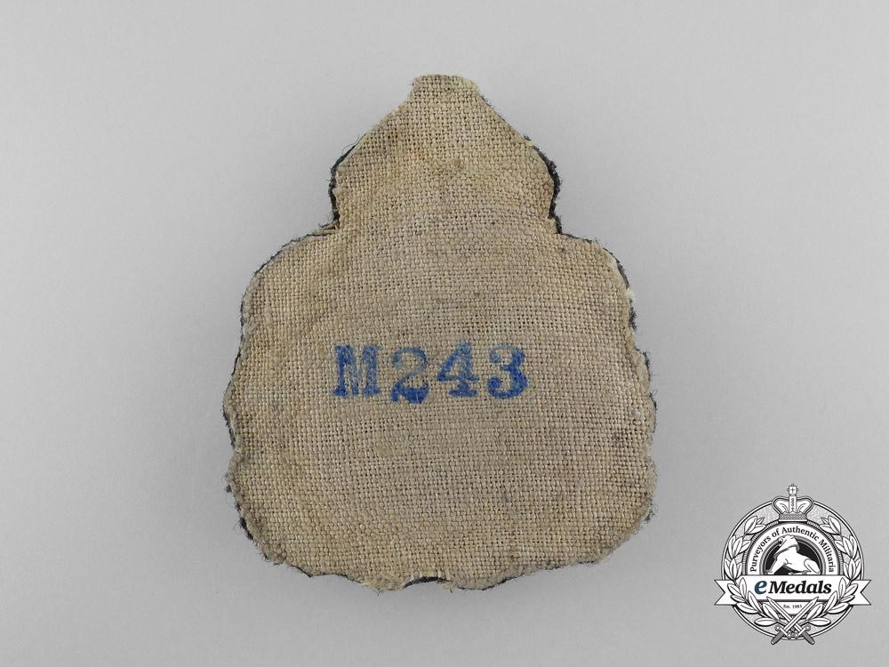 An Imperial German Navy (Kaiserliche Marine) Ensign (Fähnrich) Cap Badge