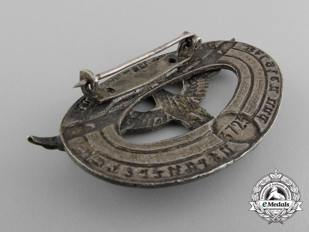 A Wehrmacht Military Administration Service Badge for Belgium and France
