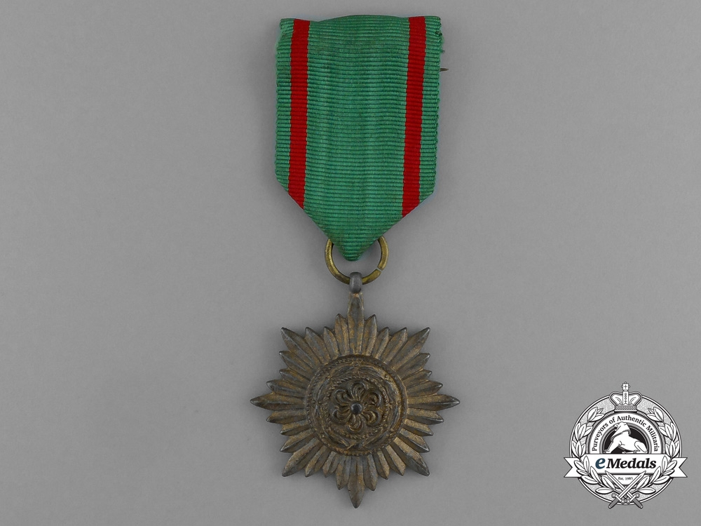 A Gold Grade Eastern People Bravery Decoration; 2nd Class by R. Wächtler & Lange in its Packet of Issue