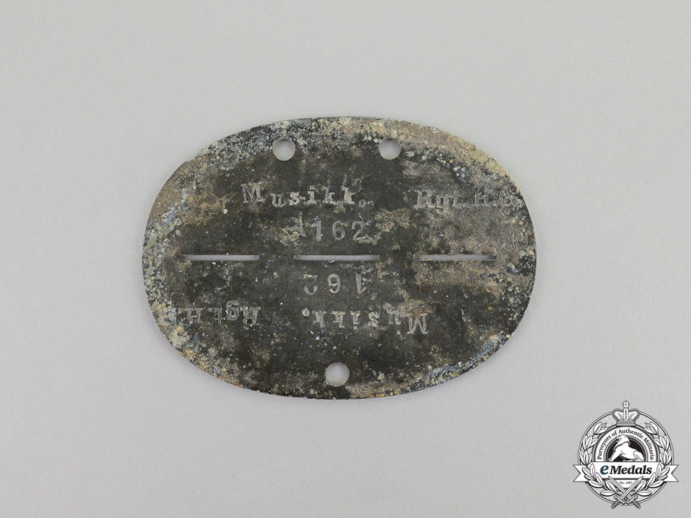 "Germany. A  Music Corps ""Regiment Hermann Goering"" Identification Disc"