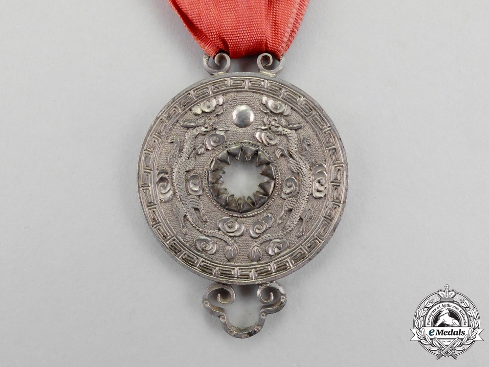 China, Empire.  A Precious Star (Pao Xing) Merit Medal