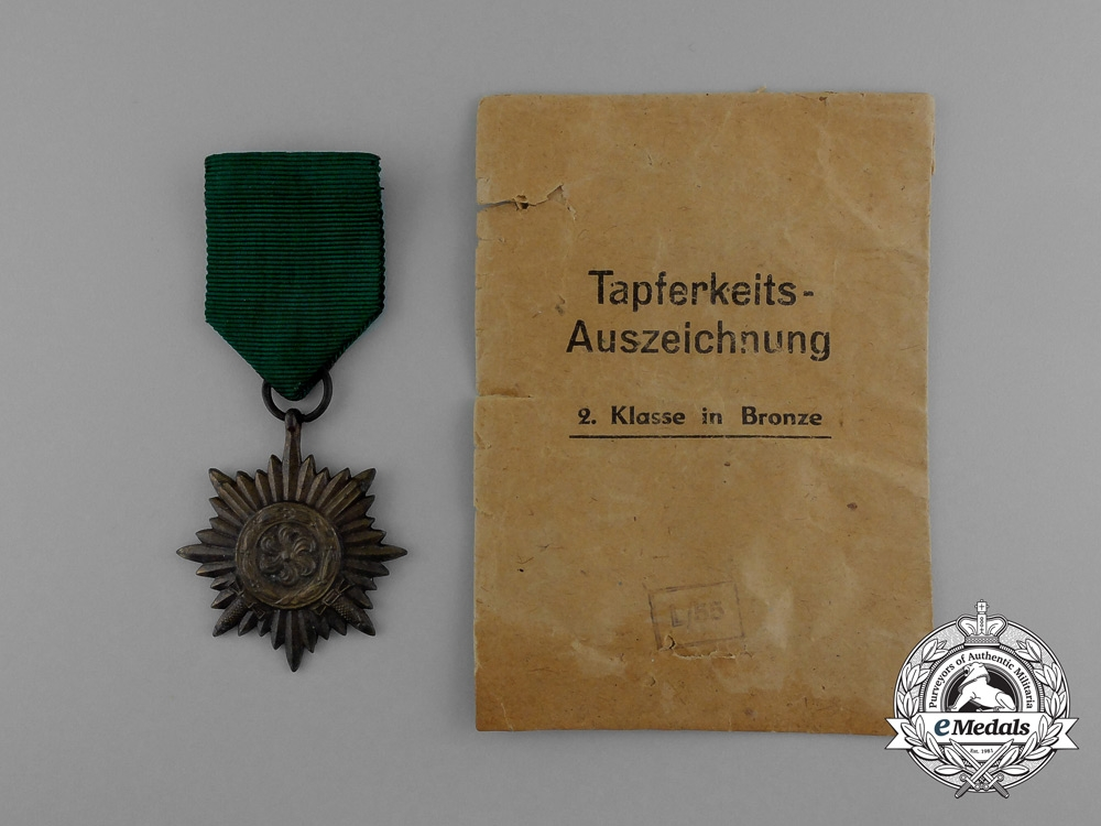 A Bronze Grade Ostvolk Merit Medal with Swords in its Original Packet of Issue by Rudolf Wächtler & Lange