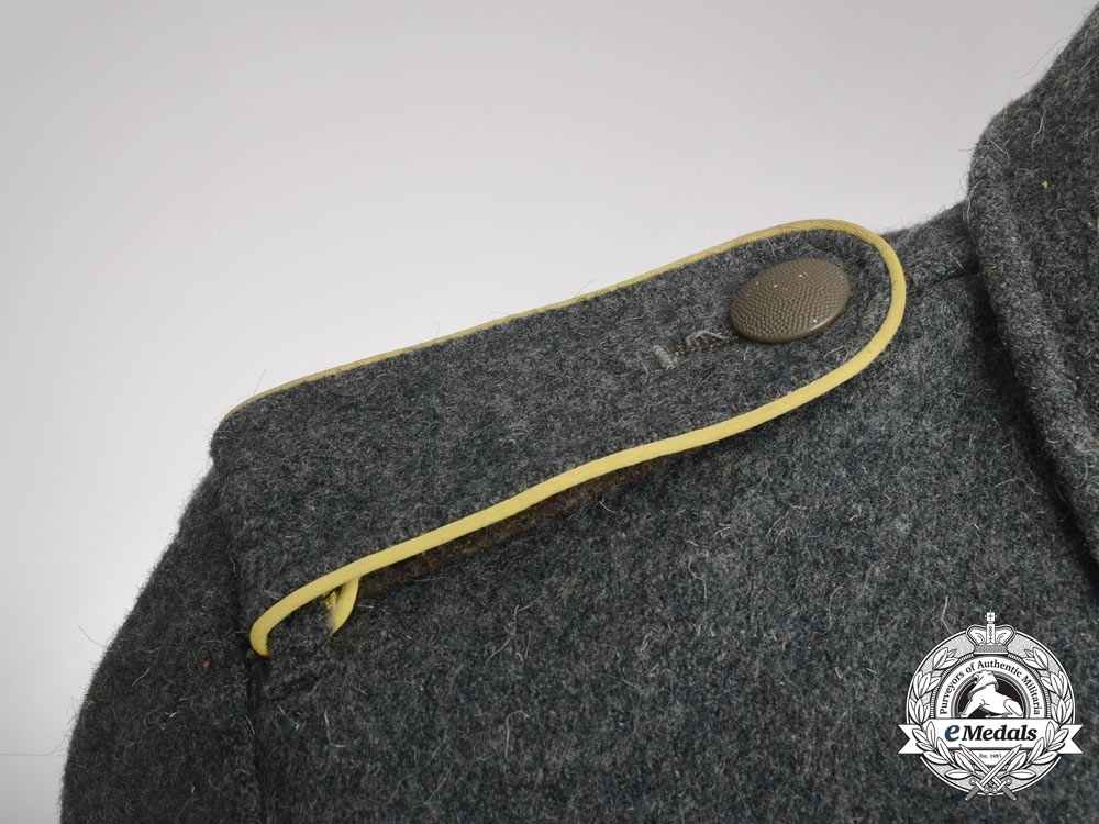 An Army (Heer) Signals Enlisted Man's M44 Field Blouse