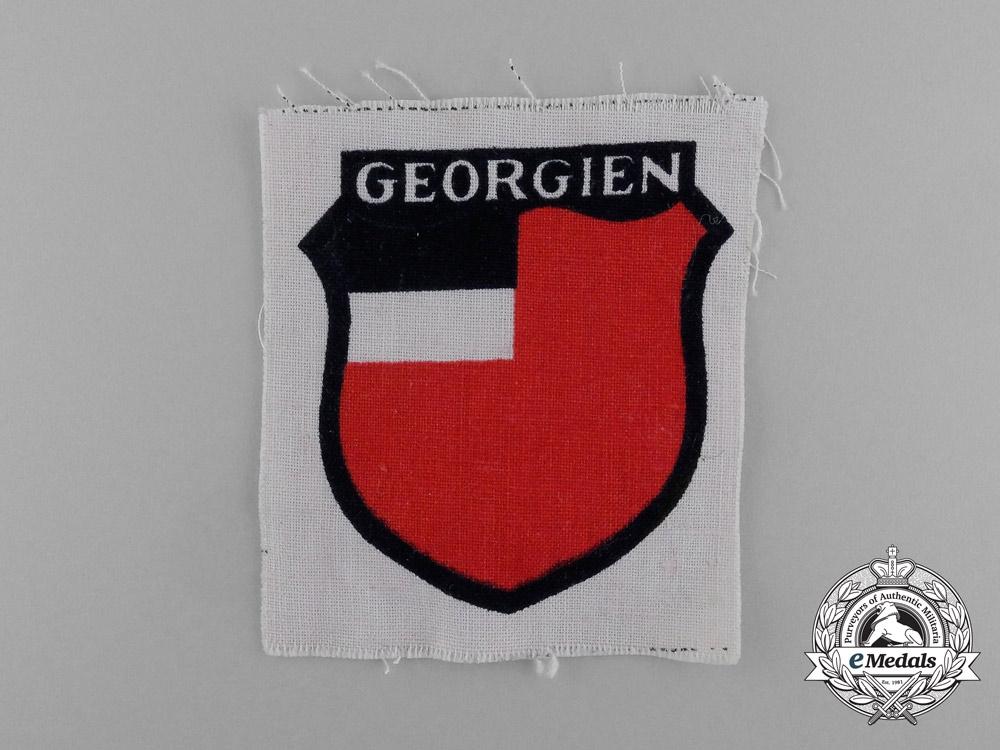 """An Unissued Wehrmacht Heer (Army) """"Georgien"""" Eastern People's Volunteer Sleeve Insignia"""