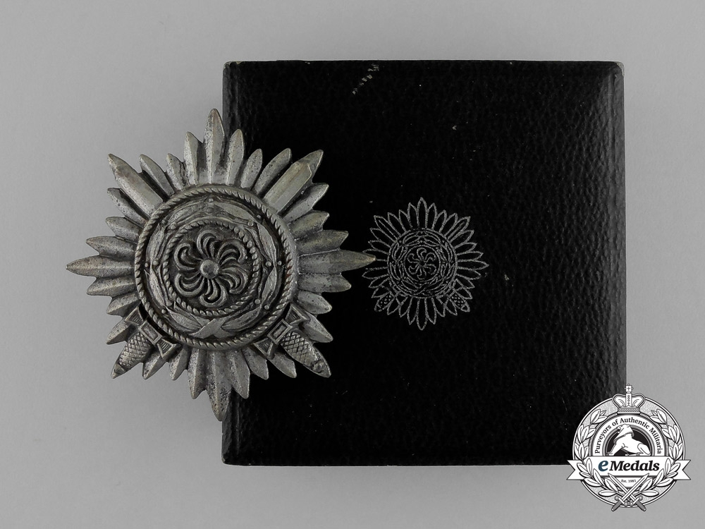 A Silver Grade Eastern People Bravery Decoration with Swords; 1st Class; in its Original Case of Issue